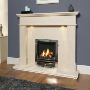 Barcelo Limestone fireplace with added downlights shown with an inset gas fire finished in chrome with a coal fuel bed