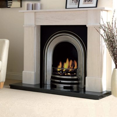 Evora limestone fireplace shown with a cast iron insert and gas fire