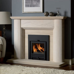Villamoura Limestone fireplace with an inset solid fuel basket