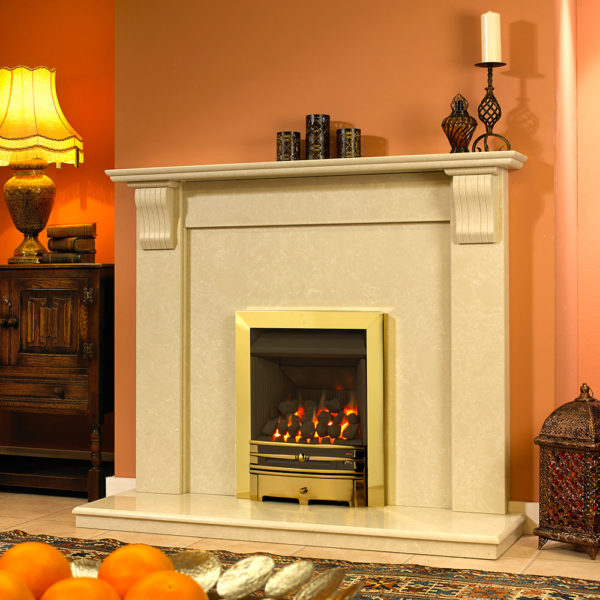 Shepton Corbel Marble fireplace shown in a Spanish Nacarado marble with an inset gas fire in a brass finish