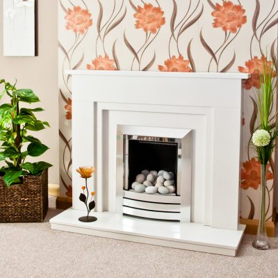 Stepped Wendle marble fireplace in a Blanco Micro marble. Shown with a full depth gas fire and pebble fuel bed