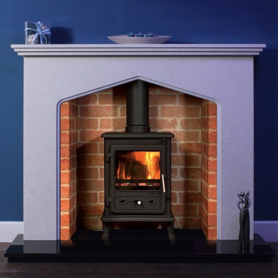 Thetford marble fireplace shown in Italian Verona grey marble with a wood burning stove